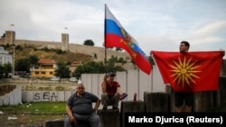 Supporters of opposition party VMRO-DPMNE hold Russian and Macedonian flags as they take part in a protest over the compromise solution in Macedonia's dispute with Greece over the country's name in Skopje last month.