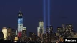 "The ""Tribute in Light"" is illuminated during events marking the 11th anniversary of the 9/11 attacks on the World Trade Center in New York."
