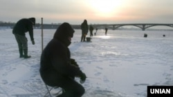 Fishermen on the frozen Dnieper River in Kyiv