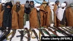 A group of 20 Taliban militants in Afghanistan's Herat Province give up their weapons on February 20.