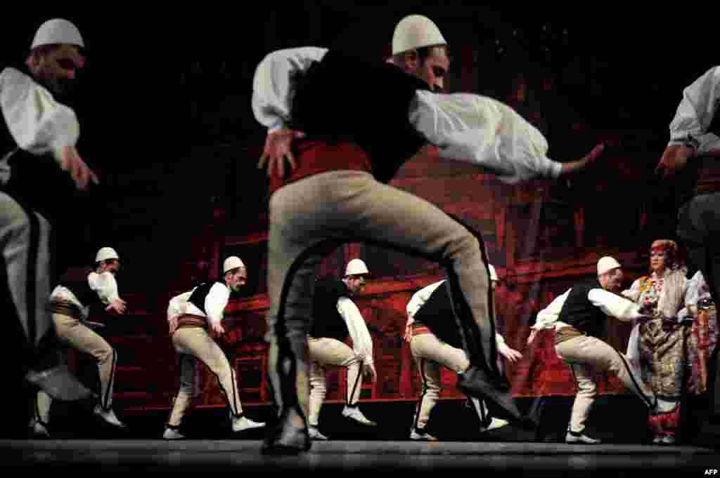 Members of Kosovo's national state song and dance Shota ensemble perform at the national theater in Pristina. (AFP/Armend Nimani)