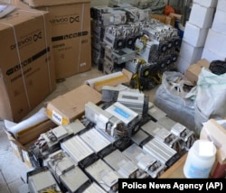 A photo provided by the Iranian police shows boxes of machinery used in Bitcoin mining operations that were confiscated by the authorities in Nazarabad.