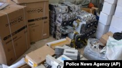 "IRAN -- A photo provided by the Police News Agency, shows boxes of machinery used in Bitcoin ""mining"" operations that were confiscated by police in Nazarabad, undated"