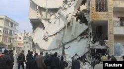 После удара российской авиации в городе Идлиб в Сирии. 20 декабря 2015 года.