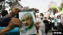 Мітинг опозиції у Тегерані. На плакаті портрет лідера іранської опозиції Мір-Хосейна Мусаві, 18 вересня 2009 р.