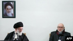 Ayatollah Ali Khamenei (left) is pictured here with a member of Egypt's Muslim Brotherhood. Khamenei says the revolts sweeping the Arab world have a spiritual kinship with Iran's own 1979 revolution.