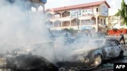 Абуджа қаласында болған жарылыс орнынан сурет. Нигерия, 25 маусым 2014 жыл.