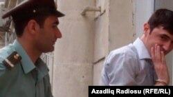 Azerbaijan -- Jailed Azerbaijani oppostion activist Tural Abbasli at court, Baku, 19Sep2011