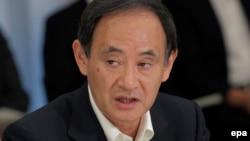 Генеральный секретарь кабинета министров Японии Ёсихидэ Суга.
