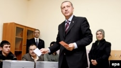 """Prime Minister Recep Tayyip Erdogan casts his vote in Istanbul. The AK leader said his party had """"learned [its] lesson."""""""