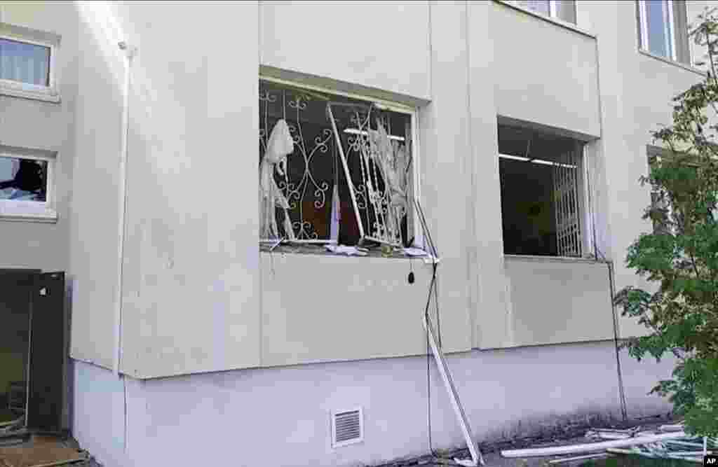 The damaged windows of the school can be seen in this image taken from video.
