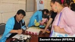 На этнической культурной выставке в Алматы. Иллюстративное фото.