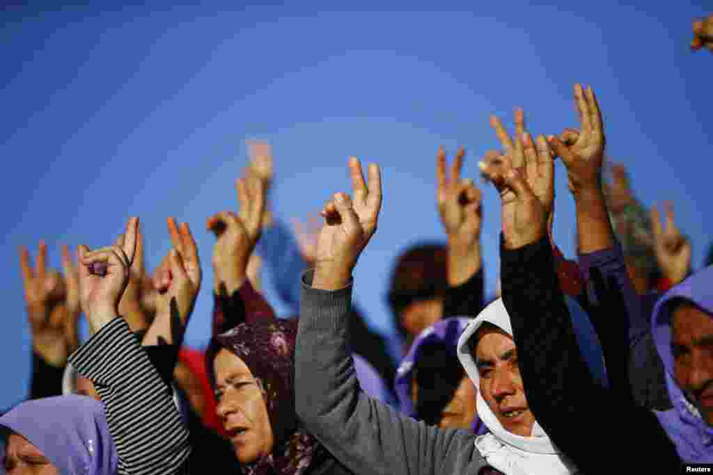 Turkish Kurdish women show the victory sign during the funeral of Kurdish fighters killed during clashes against Islamic State in Kobani, at a cemetery in the southeastern town of Suruc, Sanliurfa province on October 21. (Reuters/Kai Pfaffenbach)