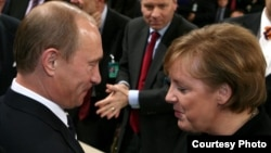 Russian President Vladimir Putin talks to German Chancellor Angela Merkel during the 43rd Munich Conference on Security Policy in 2007, the only time the Kremlin leader attended the event.