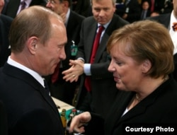 Russian President Vladimir Putin talks to German Chancellor Angela Merkel at the 2007 Munich Security Conference, an event that set the tone for tense relations between Moscow and the West.