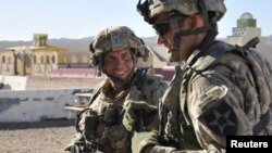 U.S. Staff Sergeant Robert Bales (left) trains at the National Training Center in Fort Irwin, California, in August 2011.