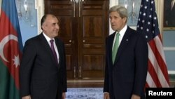 Washington -- U.S. Secretary of State John Kerry meets Azerbaijani Foreign Minister Elmar Mammadyarov at the State Department, Washington DC, 03Jun2013.