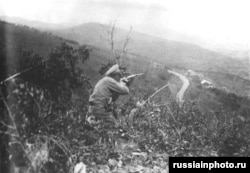 Ivan Kalmykov, a Cossack fighter allied with the Whites during the war, fires on an enemy position in Russia's Far East.