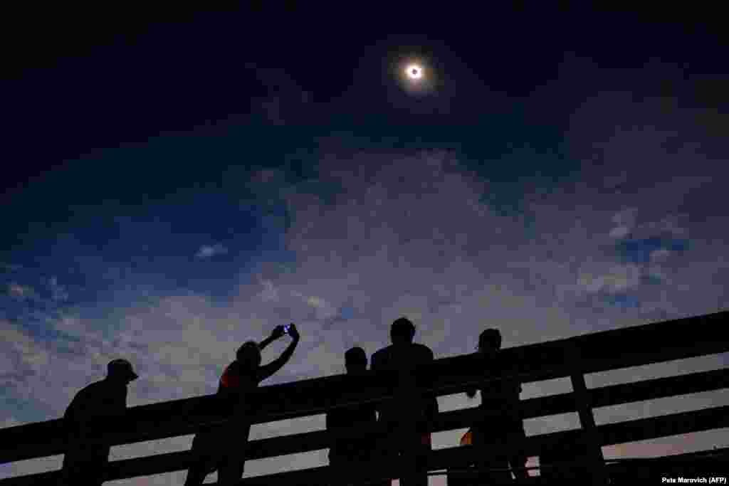Eclipse watchers were ecstatic as the clouds broke minutes before totality during the total solar eclipse from the one of last vantage points where totality was visible on August 21 in Isle of Palms, South Carolina. (AFP/Pete Marovich/Getty Images)