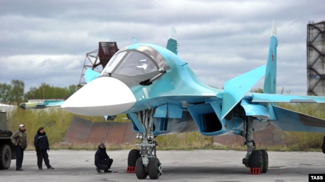 A new-generation Su-34 bomber is revealed at the Novosibirsk Aviation Plant in June.