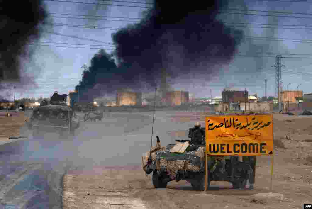 U.S. Marines enter the southern city of Al-Nasiriyah on March 23.