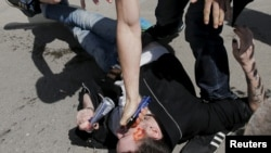 An antigay protester uses pepper spray against gay-rights activists during an LGBT rally in central Moscow in May.