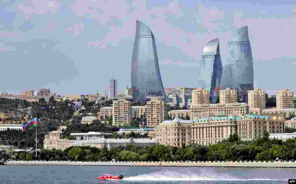 A view of the capital with the city's modern landmark, the 190-meter-high Flame Towers, dominating the skyline during a powerboat race in Baku.