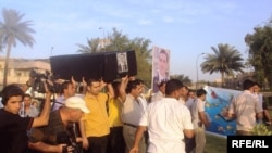 Iraqi journalists protest the assasination of a young Kurdish journalist in Baghdad in May.
