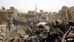 Men search through the wreckage in Kirkuk.