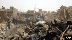 The aftermath of the bombing in Kirkuk on June 20, in which 73 people died