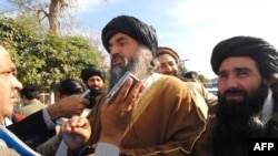 عکس تزئینی است. نمایندگان طالبان در مورد توافق این گروه با دولت صحبت می کنند.