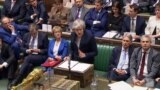 A video grab from footage broadcast by the UK Parliament's Parliamentary Recording Unit (PRU) shows Britain's Prime Minister Theresa May as she speaks in the House of Commons in London on January 15, 2019.