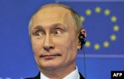 Президент России Владимир Путин на пресс-конференции в Брюсселе. 28 января 2014 года.