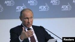 Russian President Vladimir Putin addresses international businessmen gathered ahead of the APEC summit in the eastern Russian port city of Vladivostok on September 7.
