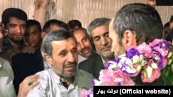 Iranian former president Mahmoud Ahmadinejad (L) greeting his close aide Hamid Baghaei just after his release from detention, on July 26, 2017.