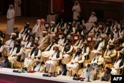 Members of the Taliban delegation attend the opening session of Afghan peace talks in the Qatari capital, Doha, on September 12.