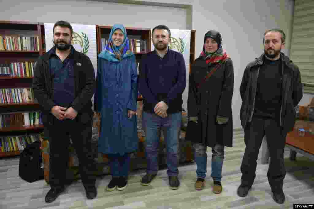 Two Czech women -- Antonie Chrastecka (second from left) and Hana Humpalova (second from right) -- kidnapped in March 2013 by armed groups linked to Al-Qaeda in Pakistan are seen in Turkey after being released on March 27. They are now back home in the Czech Republic.