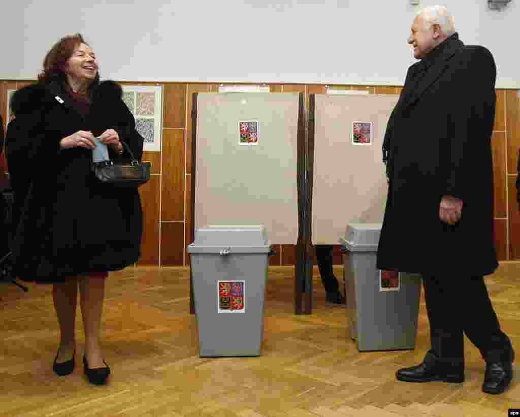 Czech President Vaclav Klaus and his wife Livia at a polling station in Prague. Klaus is leaving office after serving two five-year terms.
