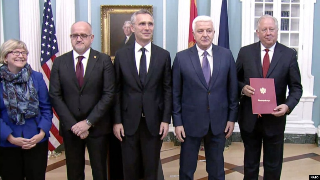 Montenegrin Prime Minister Dusko Markovic (second from right) and NATO Secretary-General Jens Stoltenberg (center) participate in the ceremony to welcome Montenegro as the alliance's newest member in Washington on June 5.