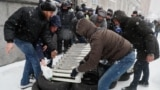 Ukrainian activists brought radiators to a protest against corruption in the gas sector on November 14 in Kyiv.