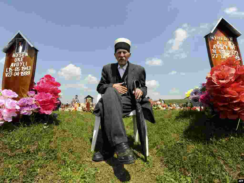 A Kosovo Albanian man attends a ceremony to mark the Day of Missing Persons on April 27 at a cemetery in the village of Meje, where a 1999 massacre by Serb forces left some 400 civilians dead. Photo by Armend Nimani for AFP