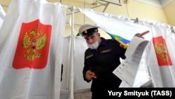 A naval cadet leaves a voting booth in Vladivostok on September 17.