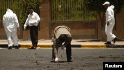 Полиция собирает улики на месте взрыва