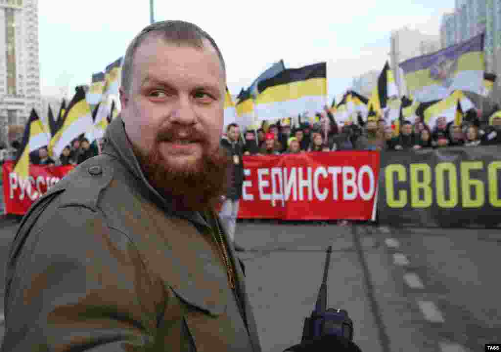 Russian nationalist leader Dmitry Demushkin takes part in the Russian March.
