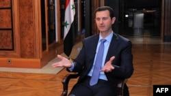 Башар аль-Асад під час інтерв'ю AFP, Дамаск, президентський палац, 20 січня 2014 року (фото прес-служби президента Сирії)