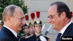 Президенти Росії і Франції, Володимир Путін (ліворуч) і Франсуа Олланд. Париж, 2 жовтня 2015 року