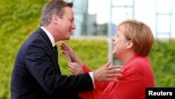 David Cameron və Angela Merkel.