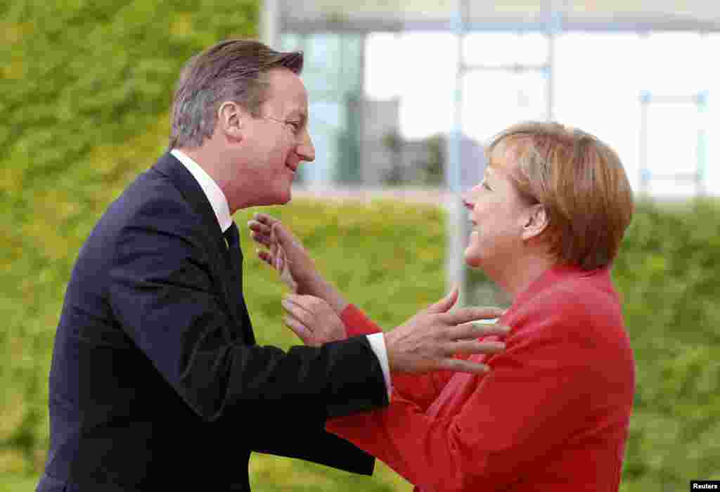 German Chancellor Angela Merkel welcomes British Prime Minister David Cameron to the Chancellery in Berlin, Germany, on June 24. (Reuters/​Axel Schmidt)