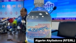 A potentially toxic aconite infusion is seen at a press conference in Bishkek on April 16.