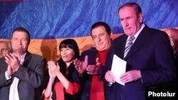 Gagik Tsarukian and senior members of his Prosperous Armenia Party applaud former President Levon Ter-Petrosian at an opposition rally in Yerevan on October 10.